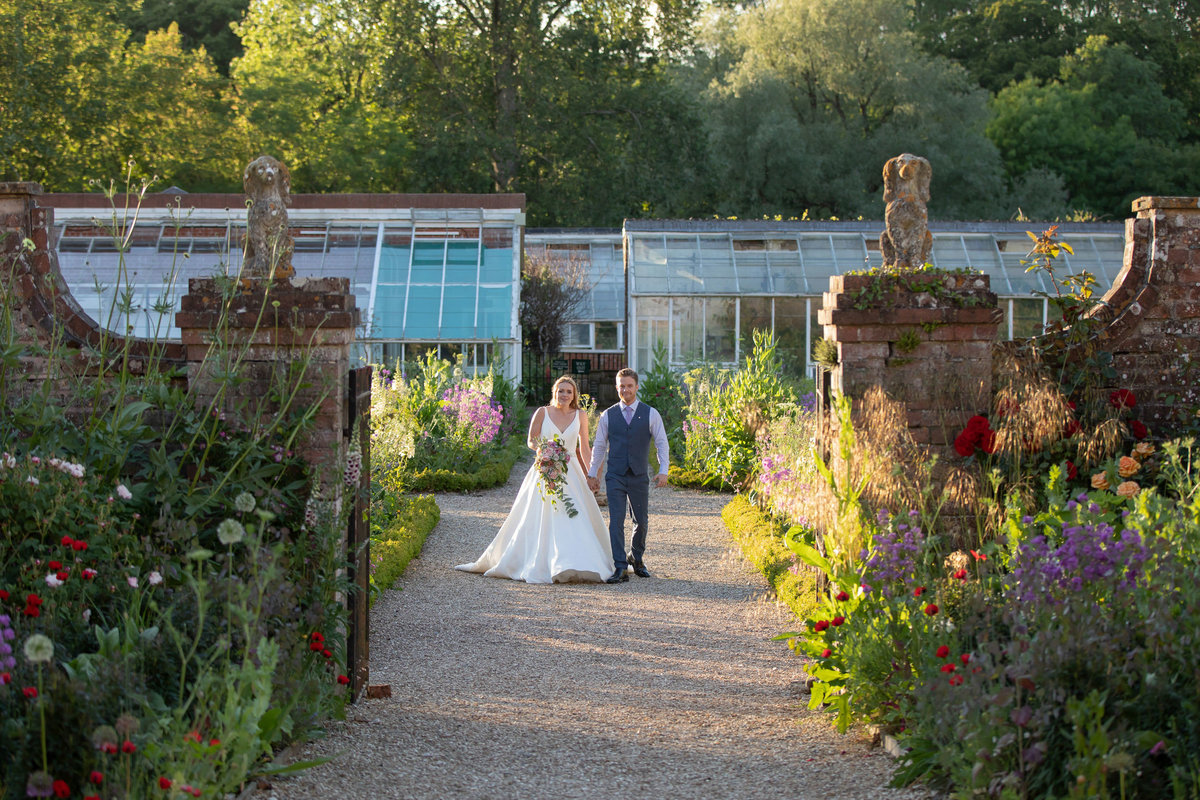 Bride and Groom in front of the greenhouses at Forde House Wedding in Somerset_