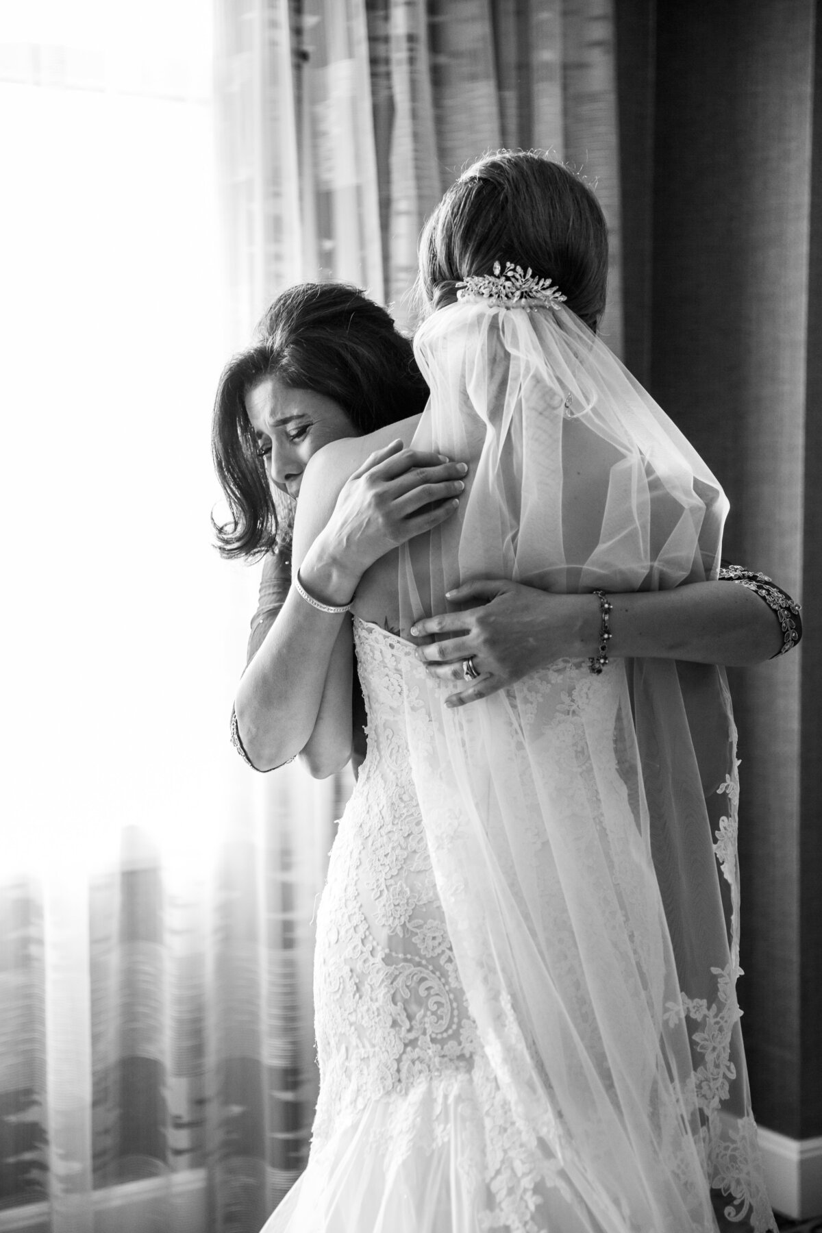 Emotional Moment Between Mom and Bride