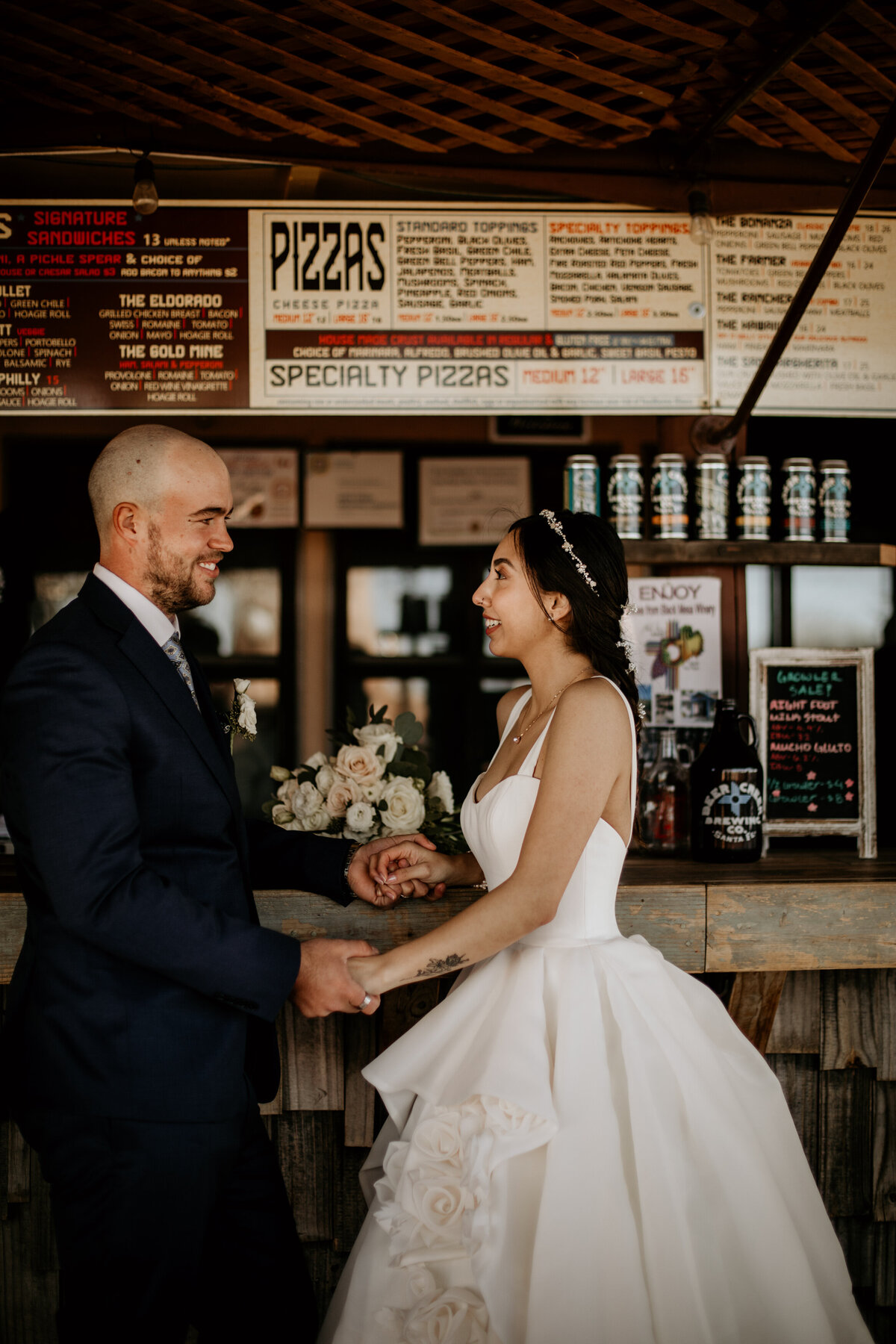 bride and groom standing at a bar together in New Mexico