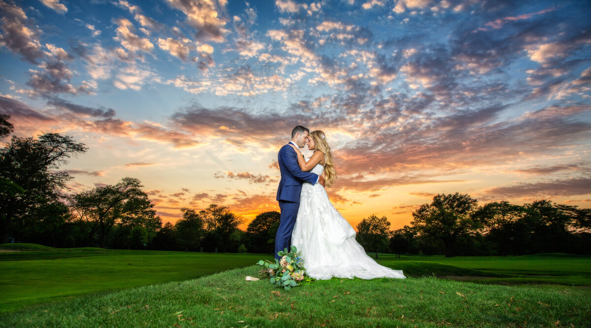 A sunset couple portrait at an outdoor wedding at Ravisloe Country Club.