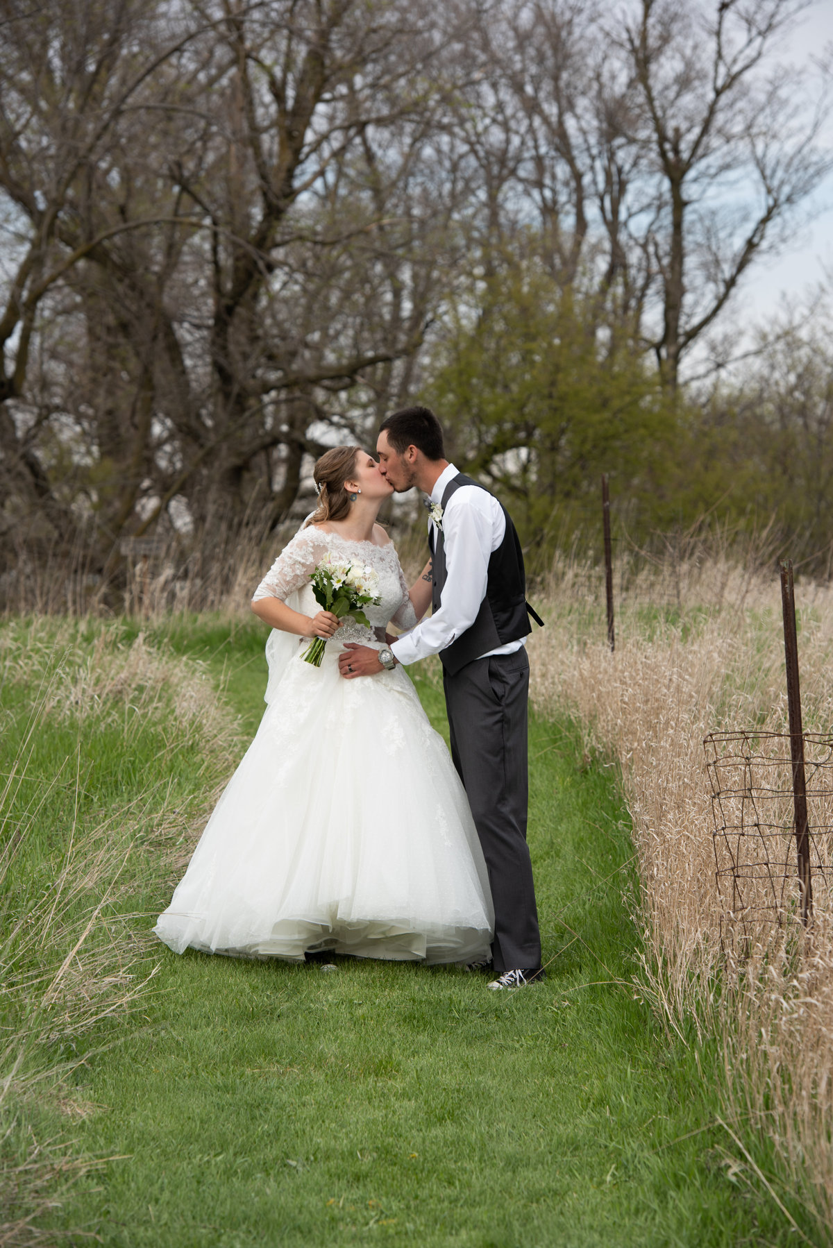 natural grass aisle bride wears sleeves