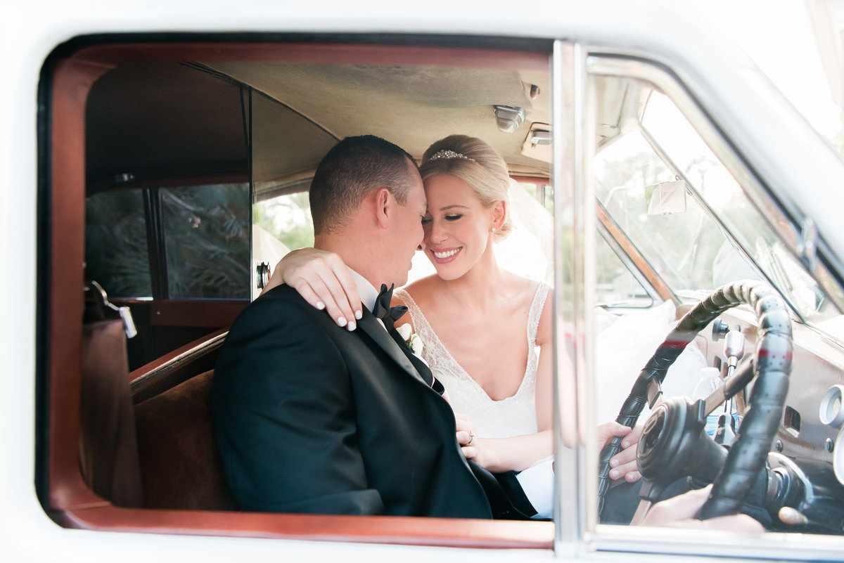 bride and groom in a white vintage car at the JW Marriott Resort and Spa Las Vegas