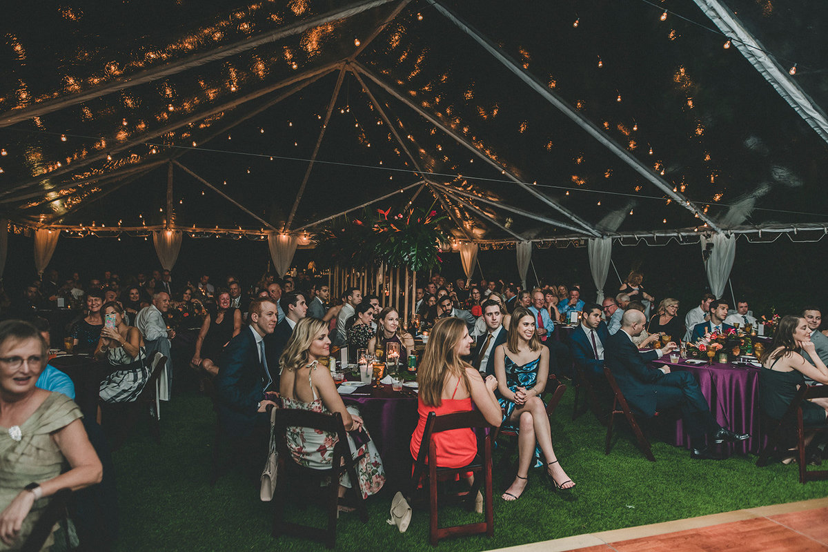 clear tent with market lighting for a garden reception