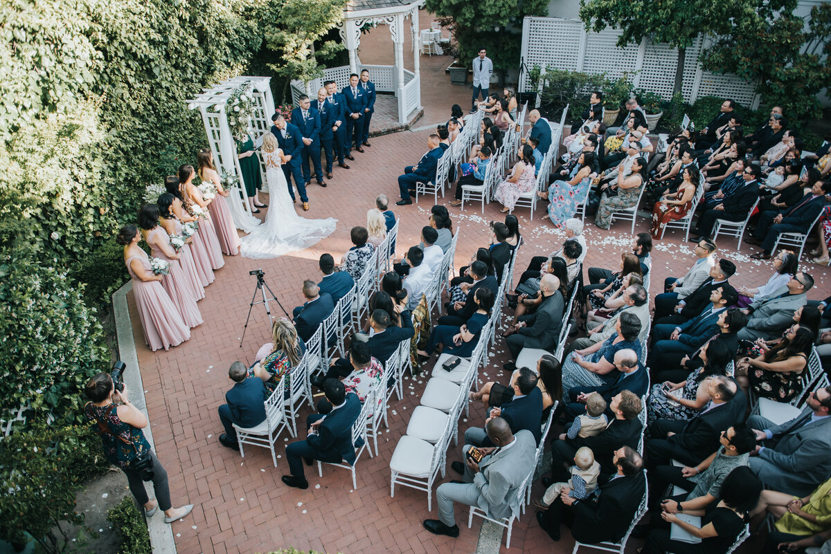 Our couple exchanges their vows on a Spring evening with their loved ones watching in our Gardens Courtyard.