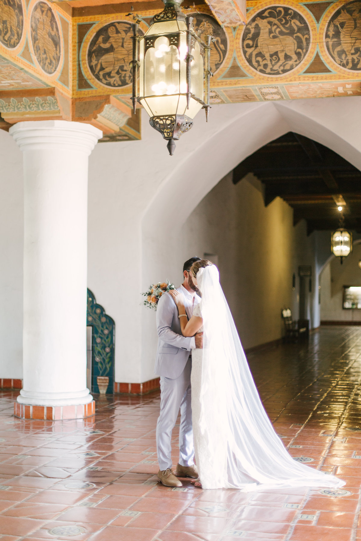 Groom kisses bride at Santa Barbara Courthouse wedding