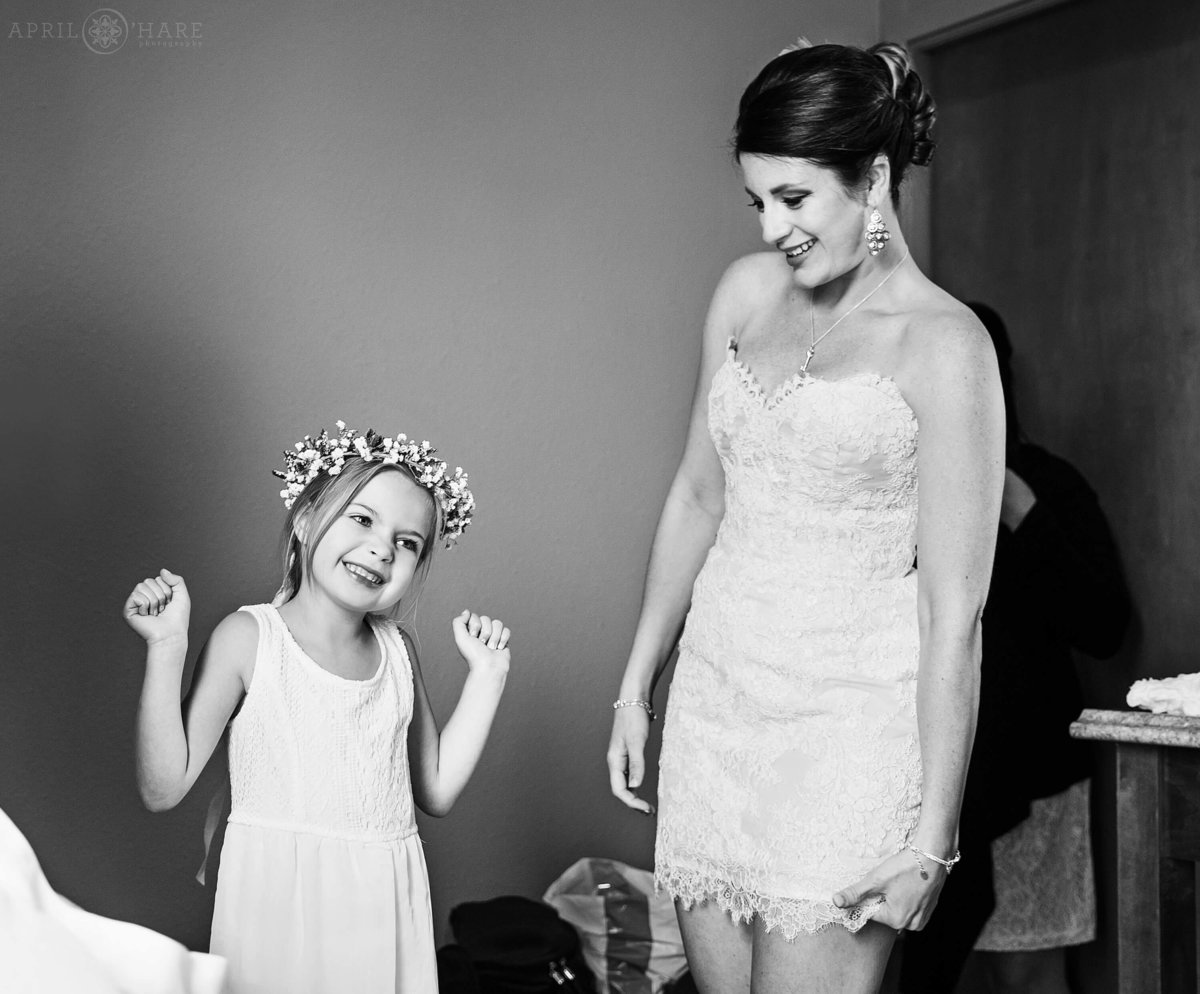 Flower girl is delighted with her flower crown at a Denver wedding in Colorado