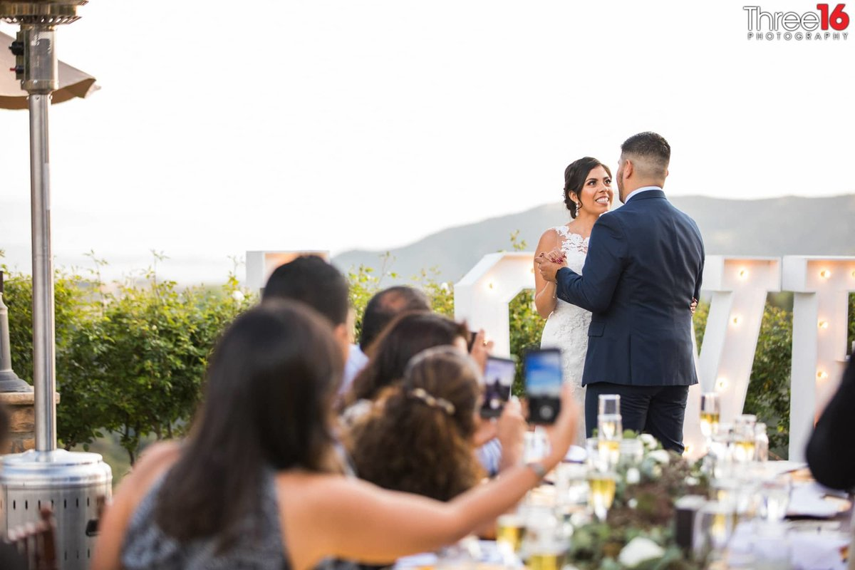Bride and Grooms first dance at outdoor reception area