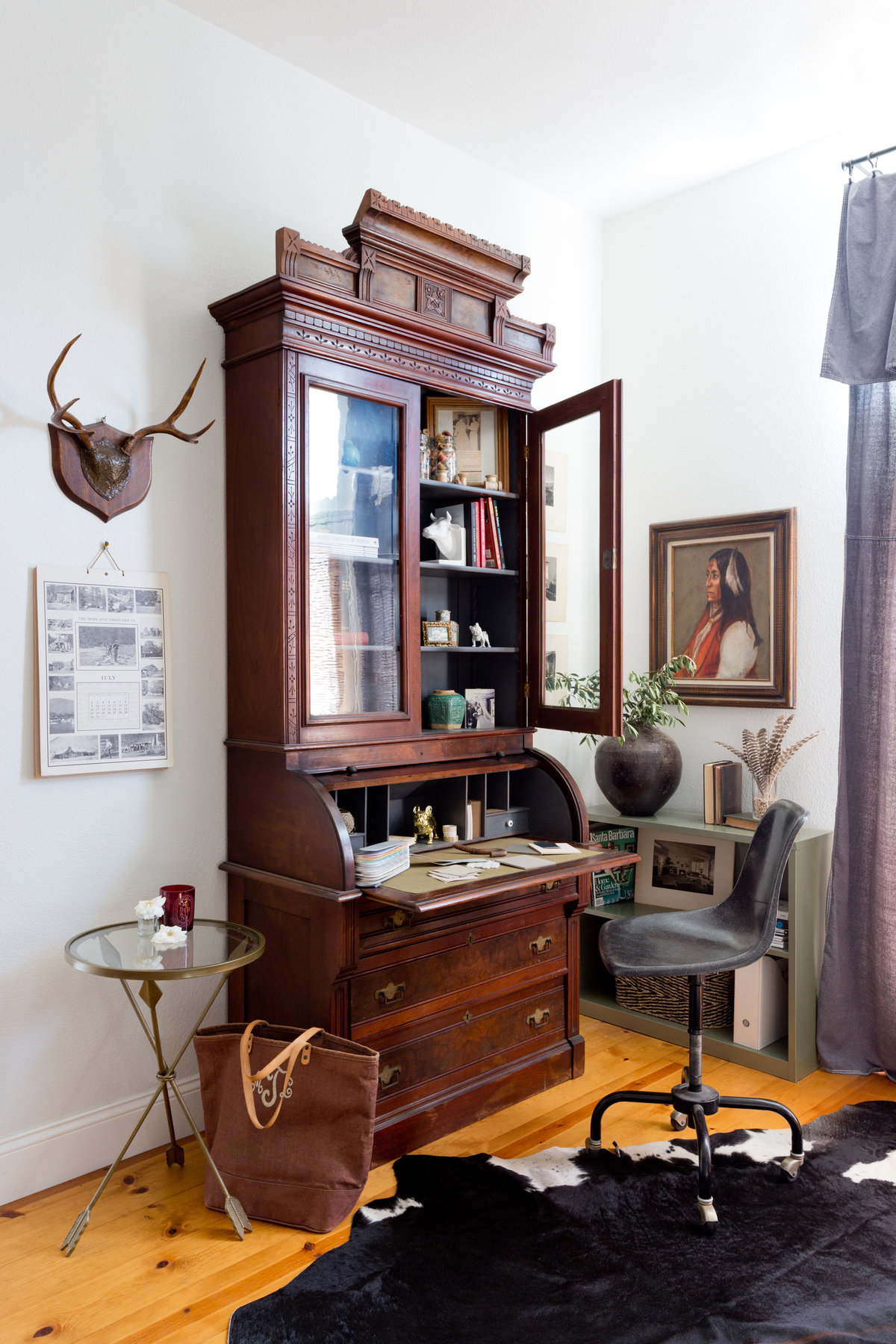 Antique desk and bookcase in the corner of home office