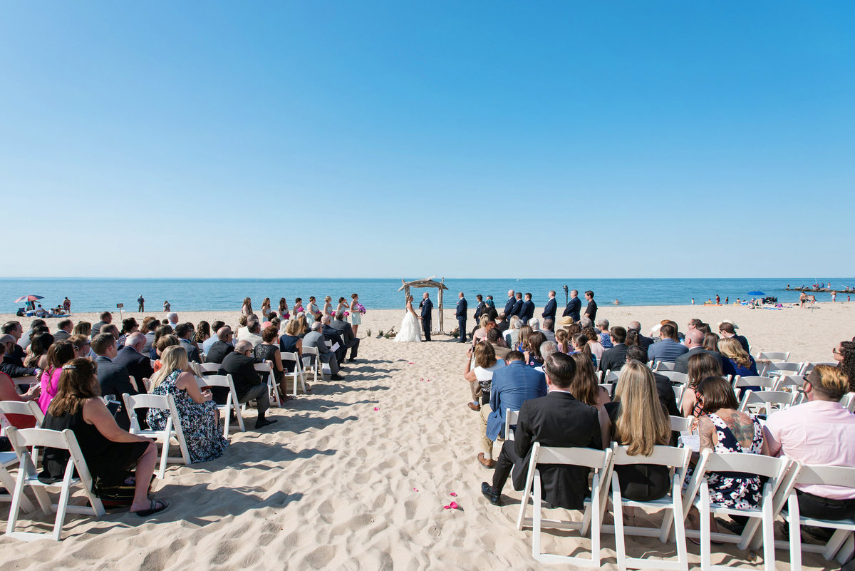 photo of wedding ceremony set up with guests on the beach at Pavilion at Sunken Meadow