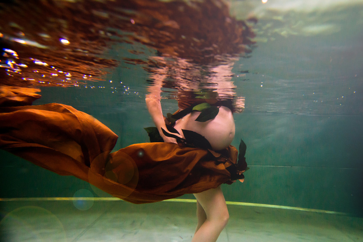 This is a precious time in your life, capture it with a pregnancy photo shoot underwater