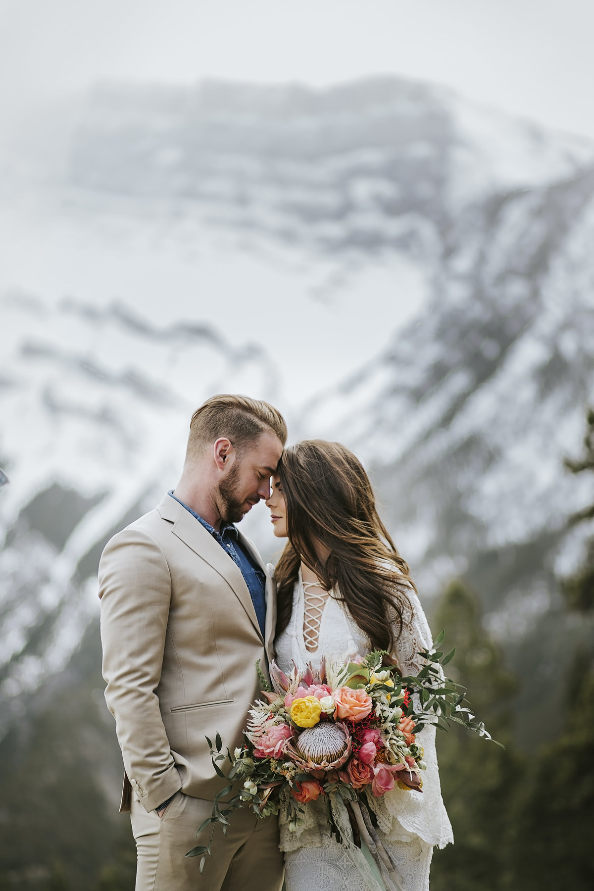 Romantic bride and groom with boho bouquet Mountain Wedding Jasper AB