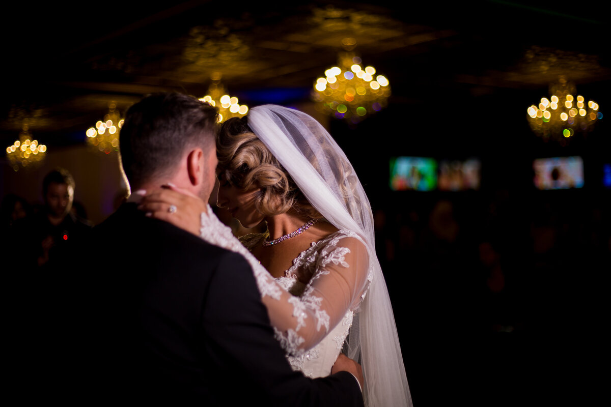 Beautiful couple share an intimate wedding moment during their first dance.