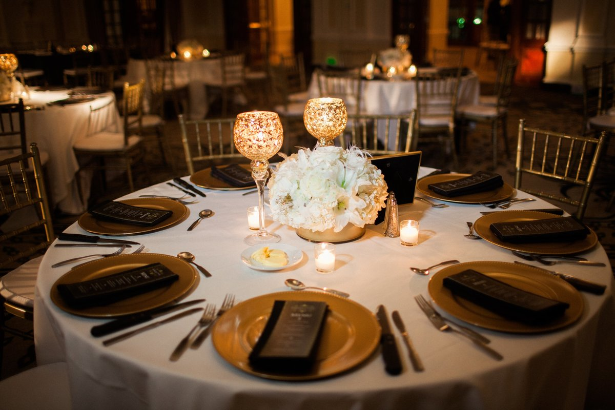 black and gold wedding reception table