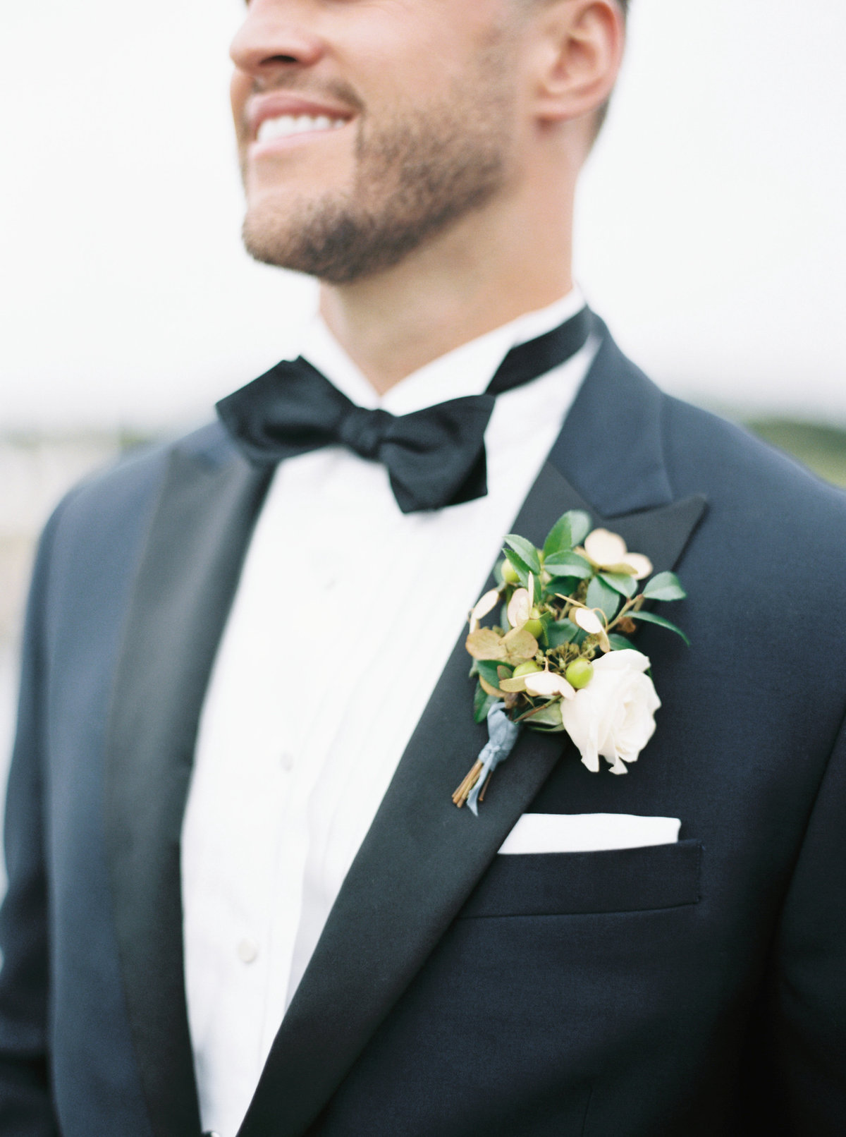unique boutonniere for black tie wedding