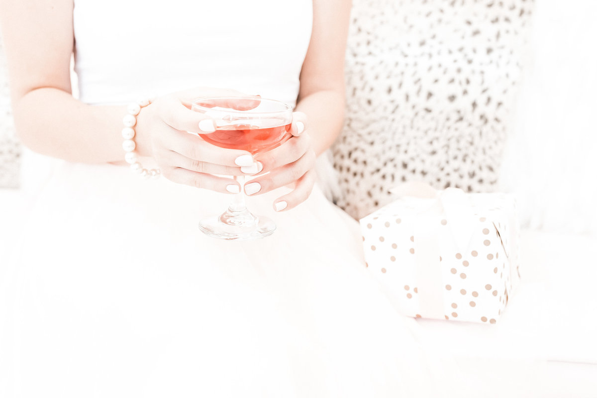 stock photo - woman holding rose wine - ll filter applied
