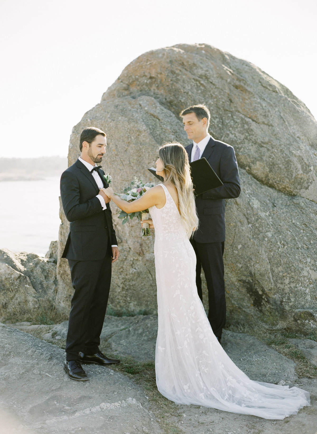 Big Sur elopement photography, bride and groom exchange vows