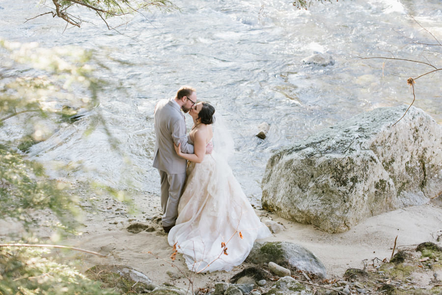 Bride and groom on river in New Hampshire