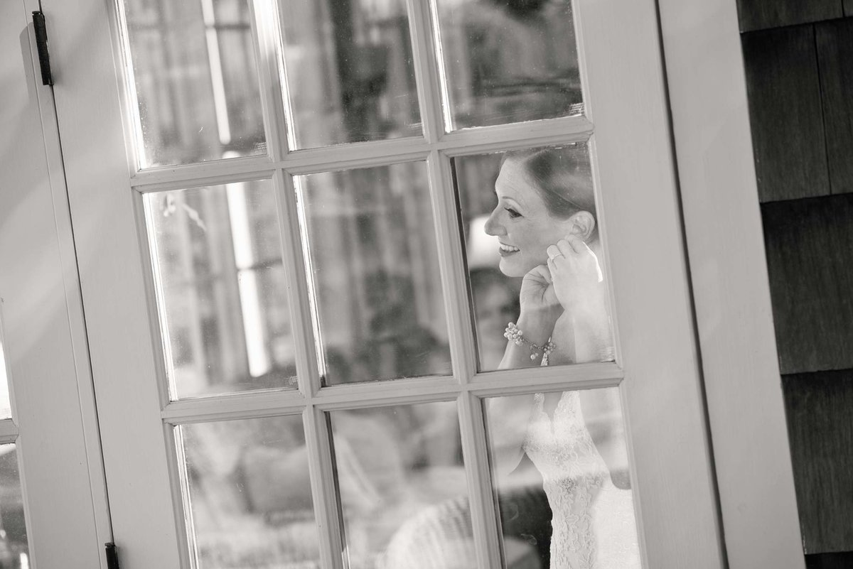 Bride in doorway getting ready at The Ram's Head Inn