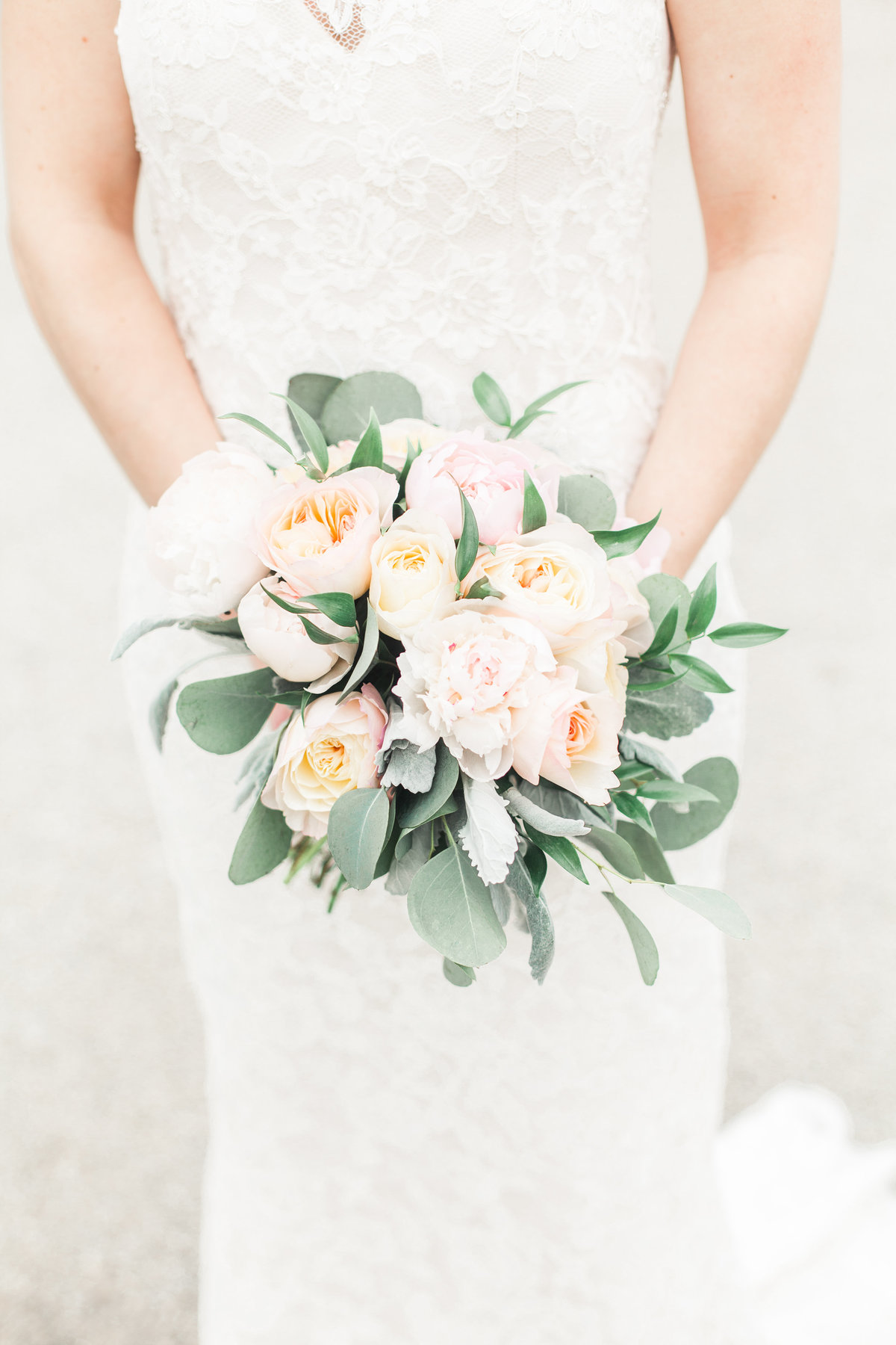 Bridal bouquet with peonies, roses, and eucalyptus