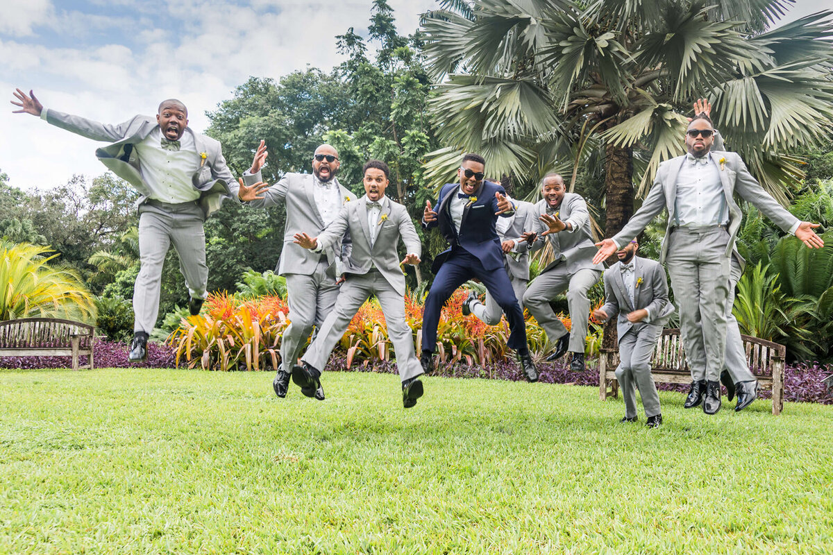 Fun photo of groom & groomsmen at Fairchild Garden by Miami Wedding Photographer for White House Wedding Photography