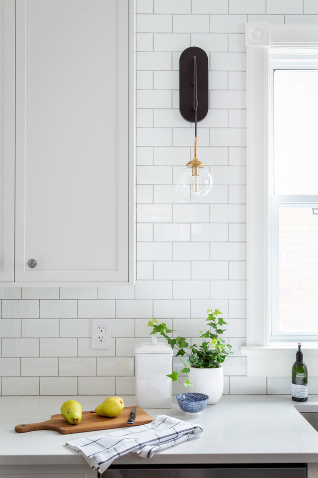 White Subway tiles - black wall sconce