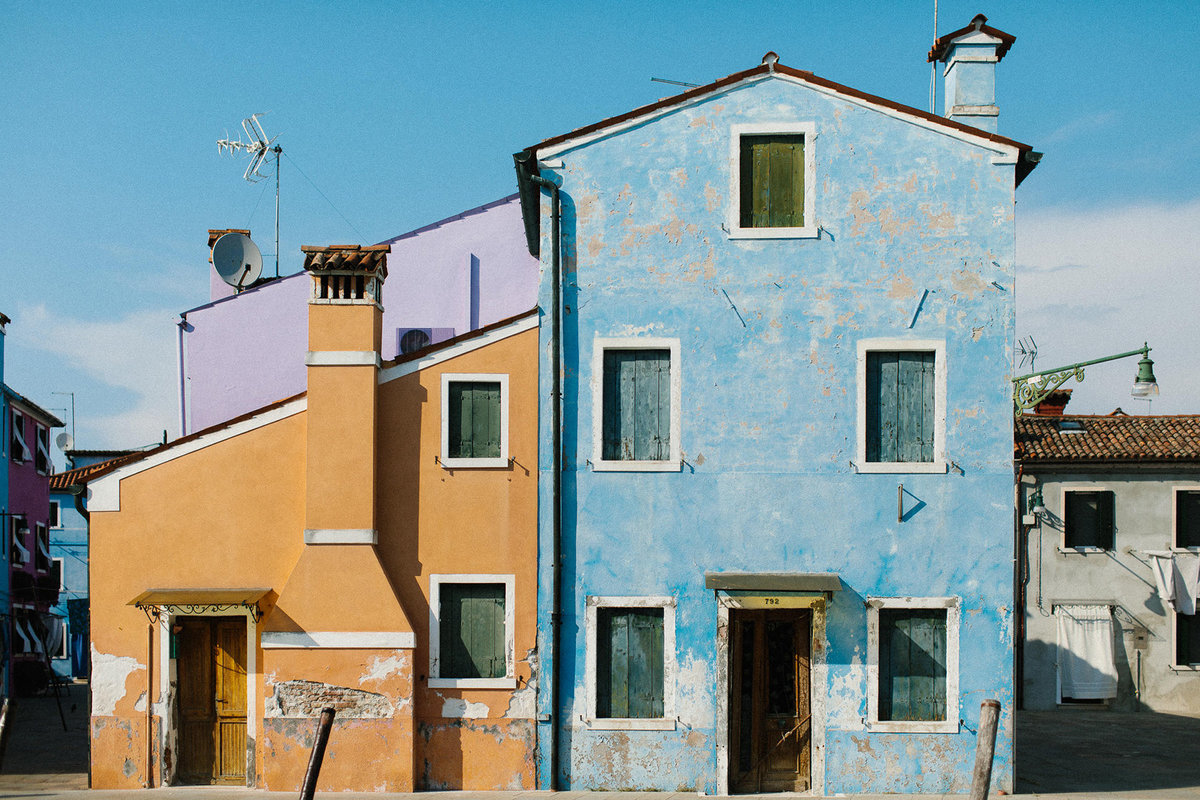 blue orange and purple painted homes in Burano Italy