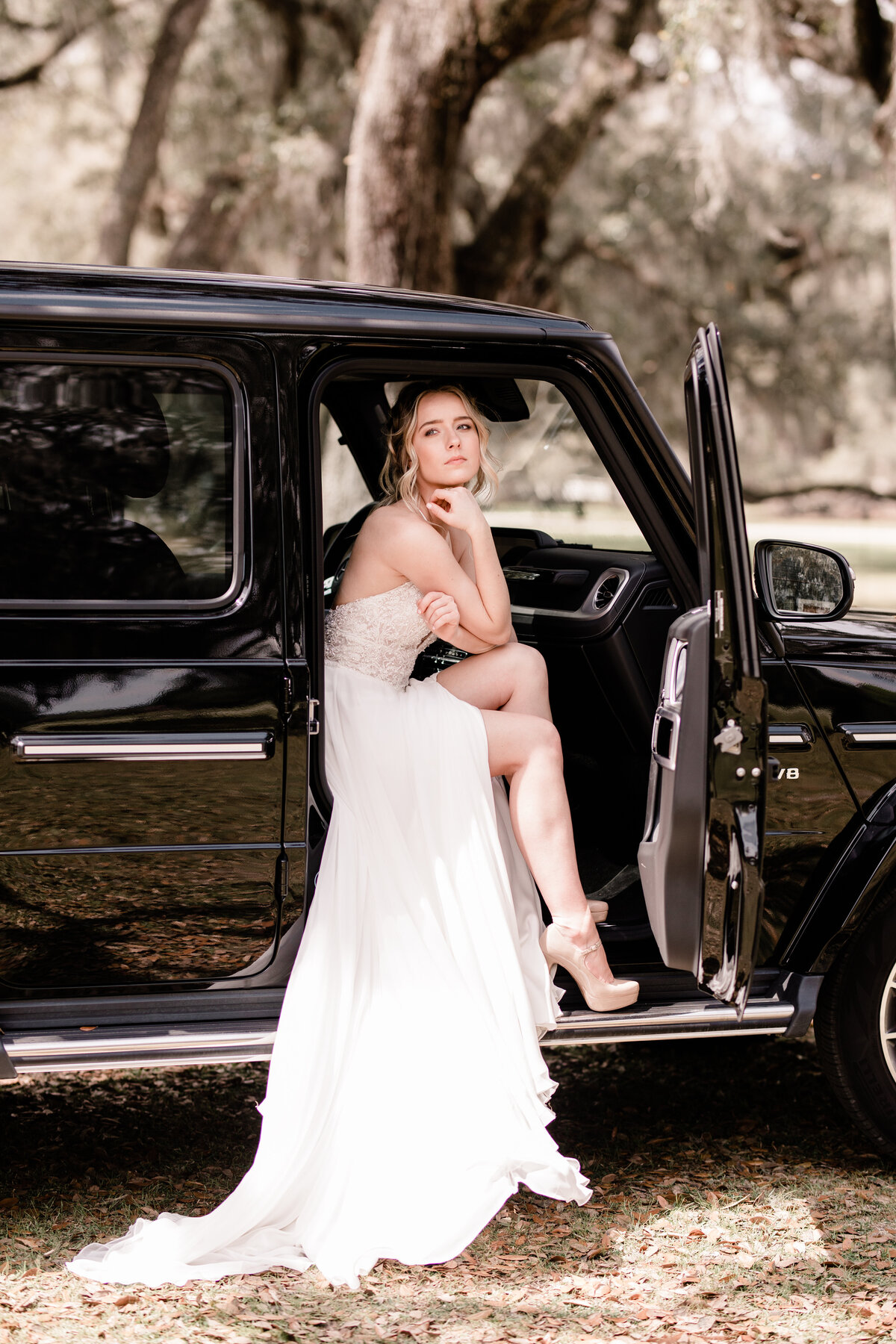 Bride sitting in Mercedes-Benz G-Class