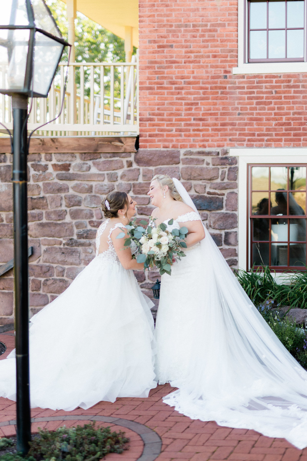 first look laughter - historic acres of hershey wedding