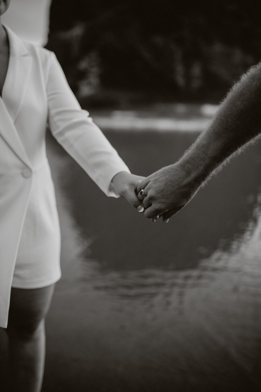 Editorial couple holding hands in black and white photo ont he beach Oregon.