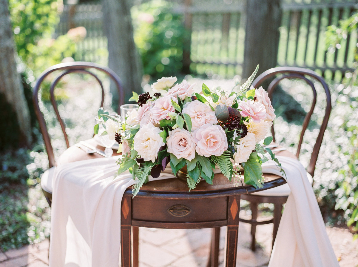 Soft pastel wedding sweetheart table created with A. Griffin Events and Amy Lauren Floral Design.