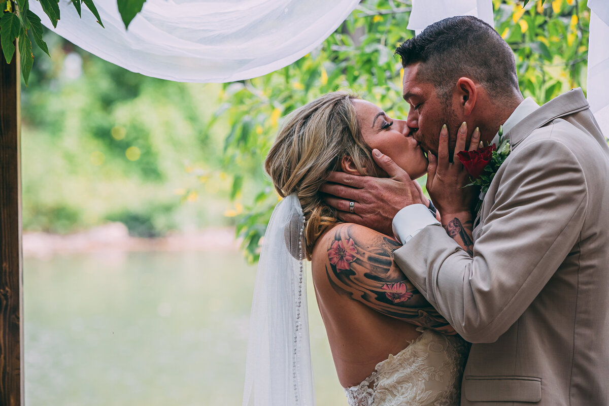 Happy couple shares a kiss on their wedding day