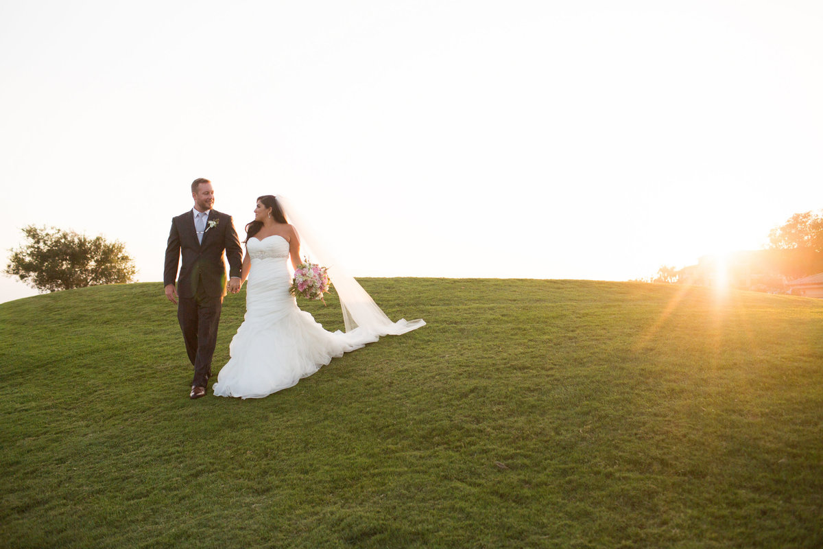 Bride and Groom portrait walking down hill at The Crossings in Carlsbad