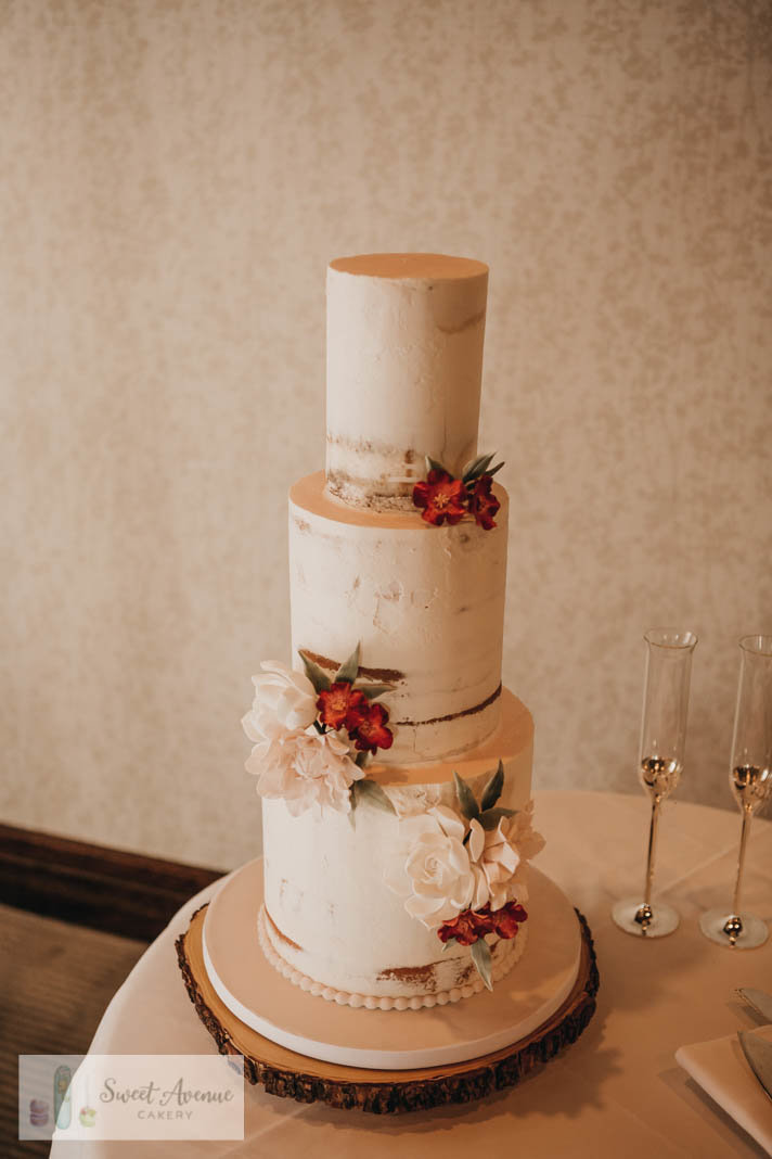 semi naked rustic buttercream wedding cake with flowers for Ancaster Mill wedding