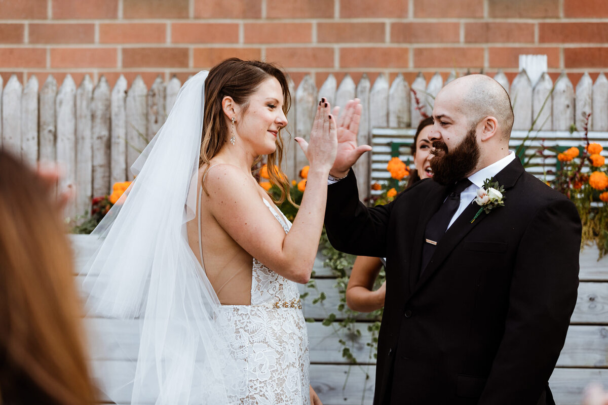 High-Five-Bride-And-Groom-Chicago