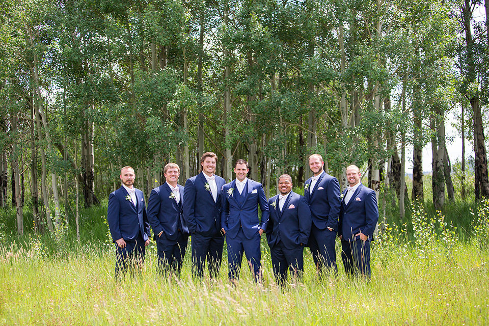 Strawberry-Creek-Ranch-Wedding-Ashley-McKenzie-Photography-Romantic-Mountain-Affair-Navy-Blush-Colorado-Groosmen-in-aspen-field