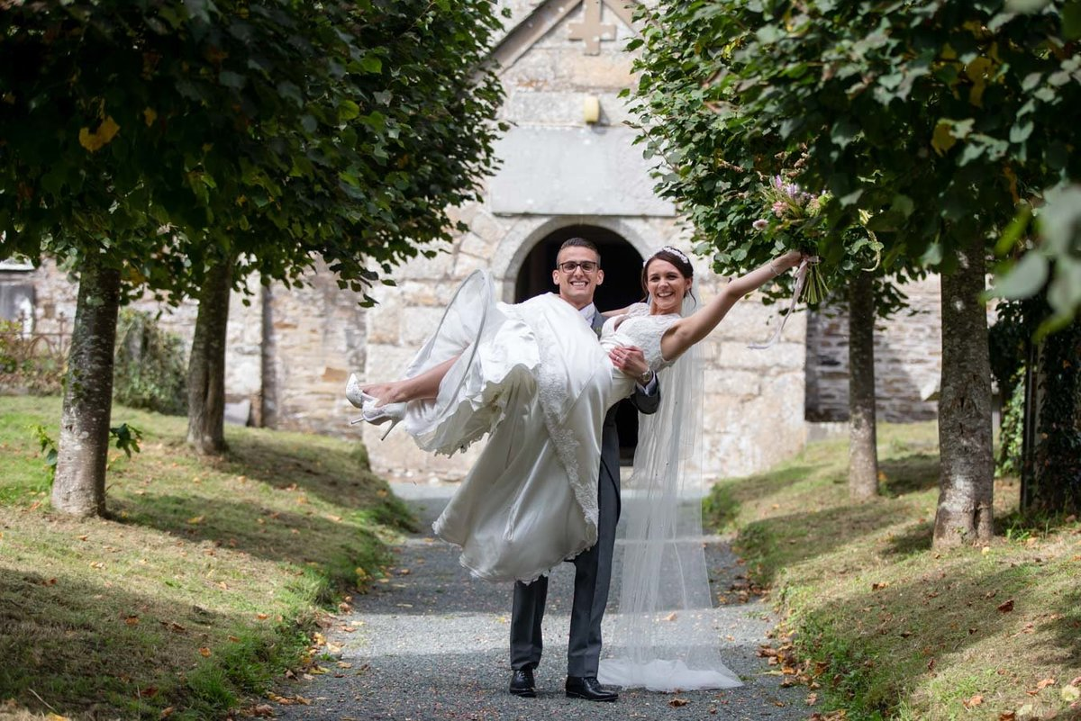 Groom carrying his Bride at Coombe Trenchard Wedding Devon