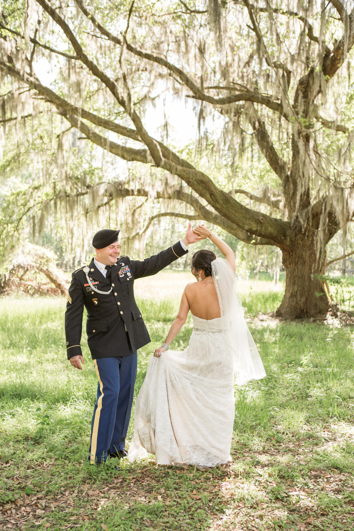 marine groom twirling bride at mackey house savannah georgia after their savannah weding