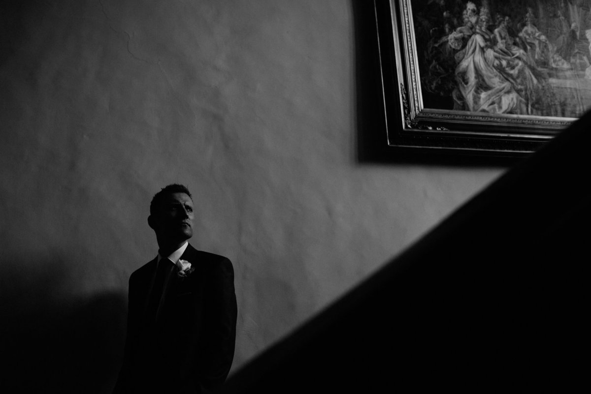 005-groom-on-stairs--goldsborough-hall-wedding-photographer--yorkshire