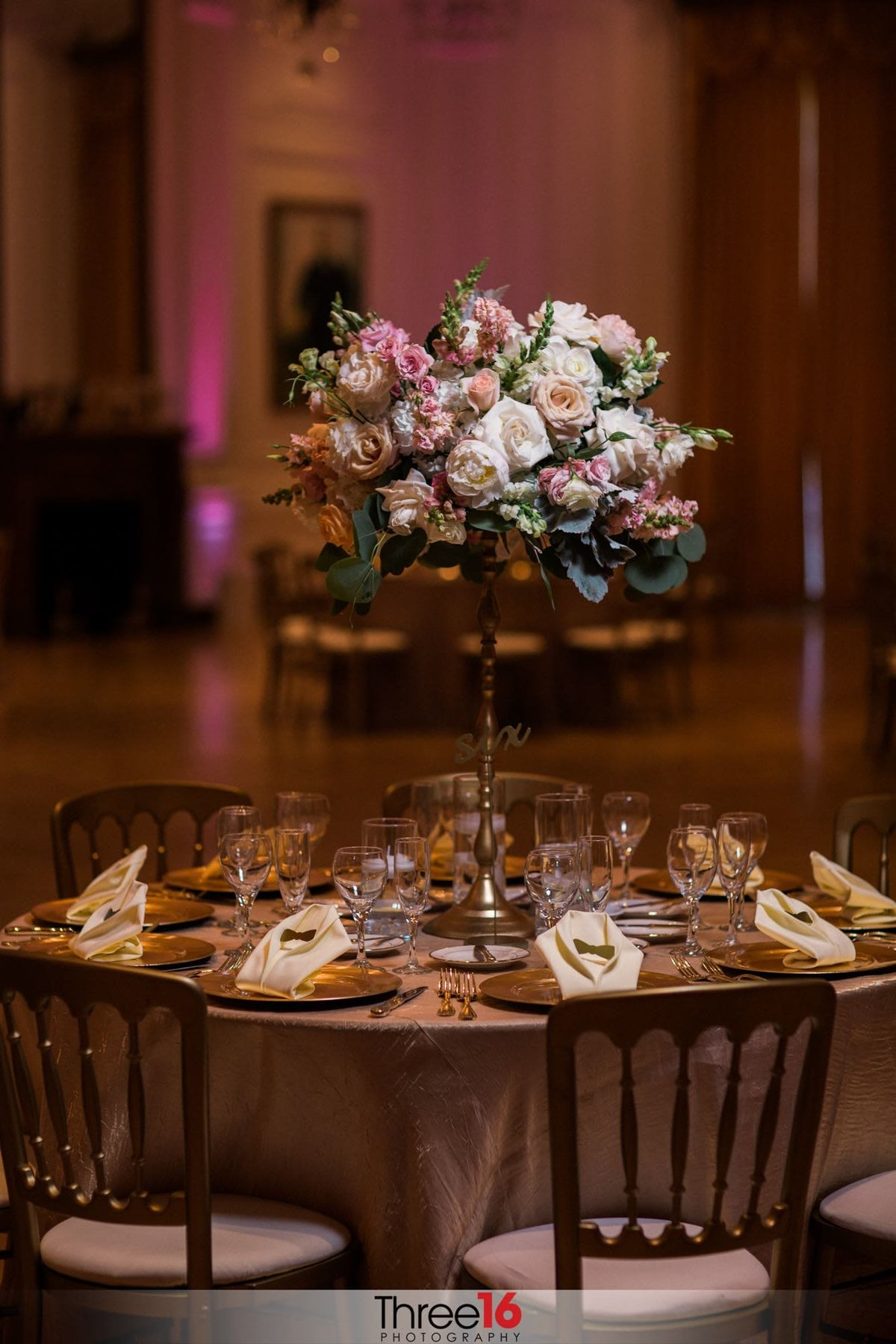 A table setup with centerpiece for wedding reception