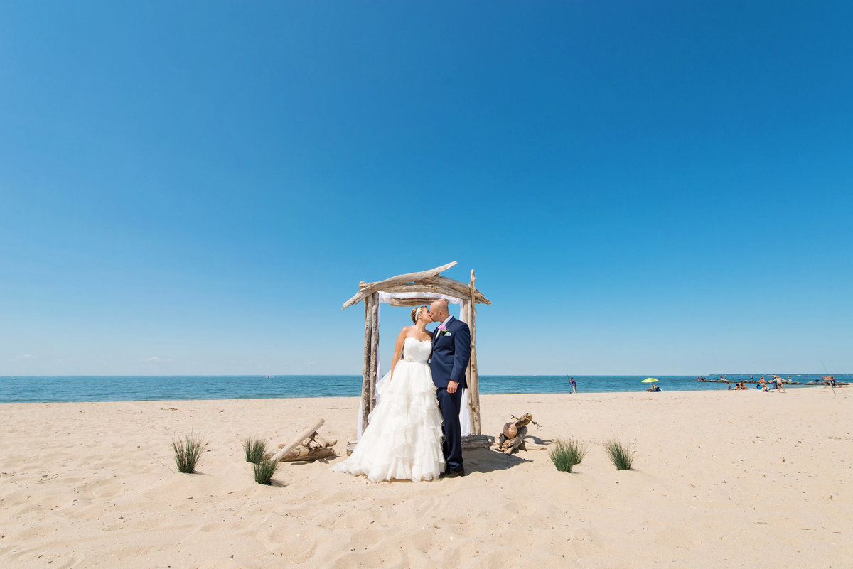 photo of bride and groom on the beach at Pavilion at Sunken Meadow wedding ceremony