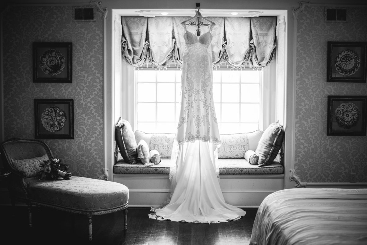 dress hanging in bridal suite at ashford estate wedding