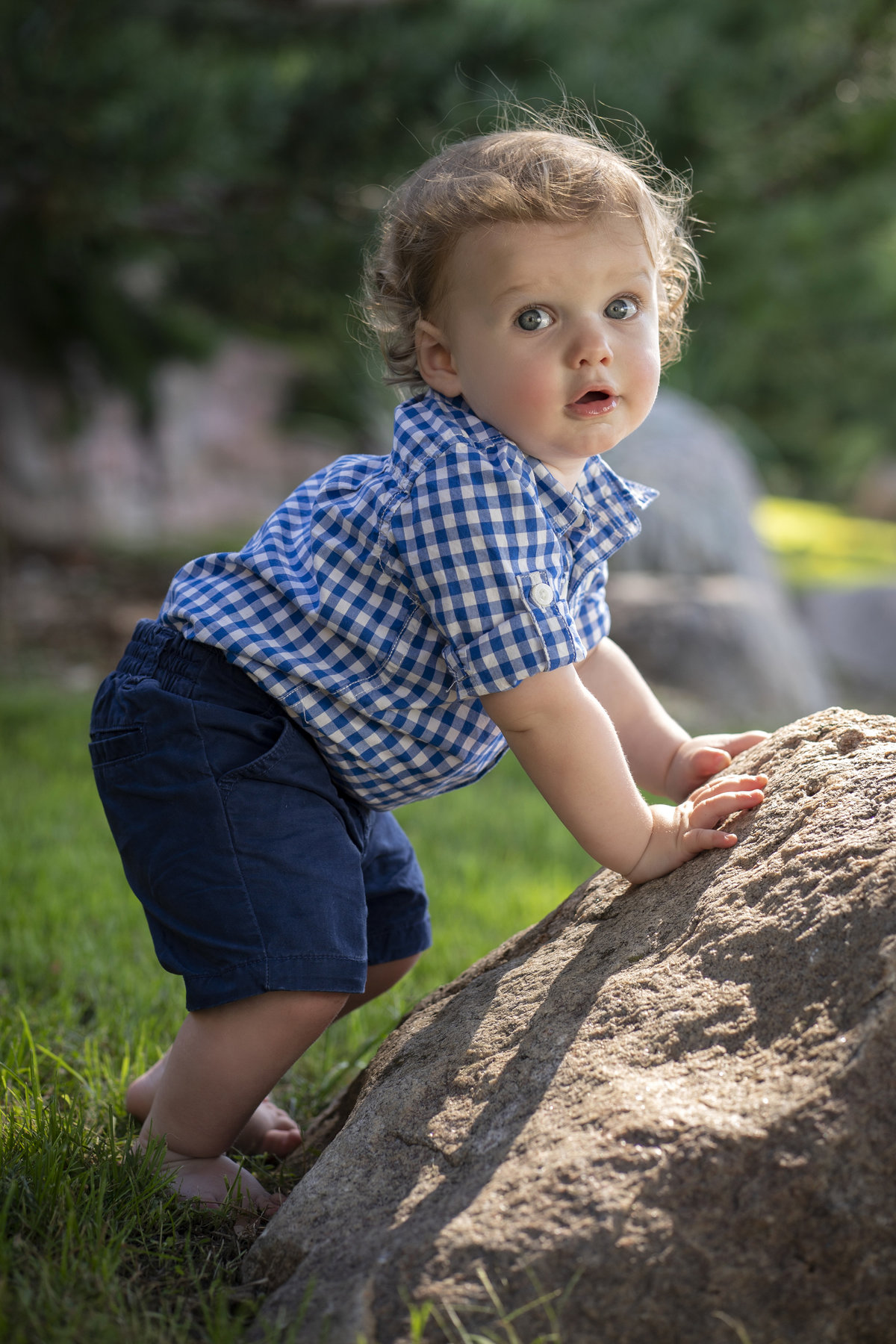 sioux falls family photography toddler standing by rock terrace park south dakota