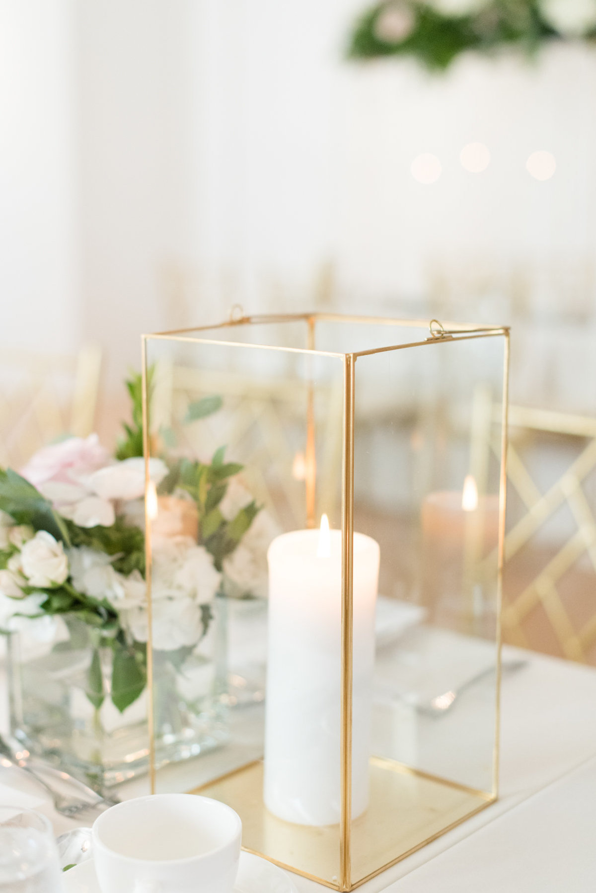 Candle in gold and glass box on the table at The Chanterellle