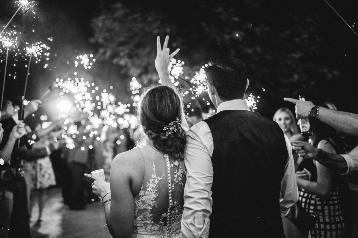 Bride & groom throw up the ASU sign during their sparkler exit in San Diego, Ca.