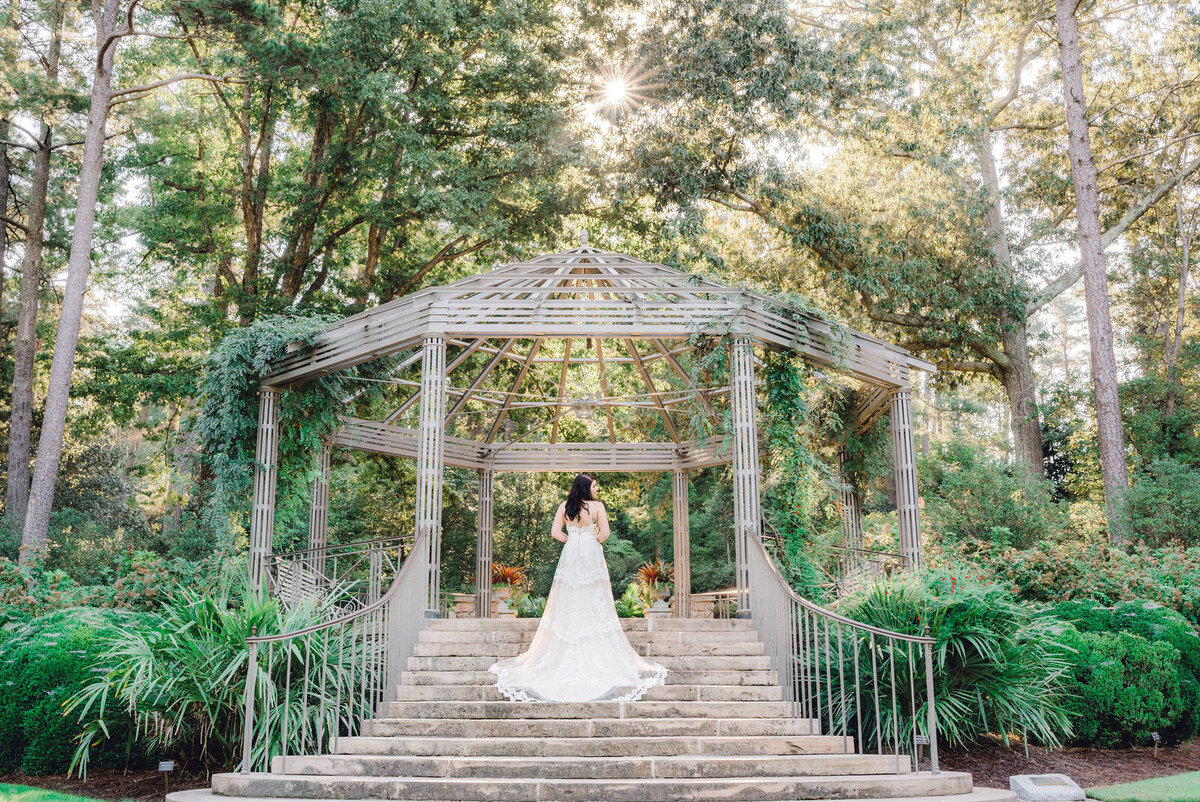 bride poses in gazebo in north carolina