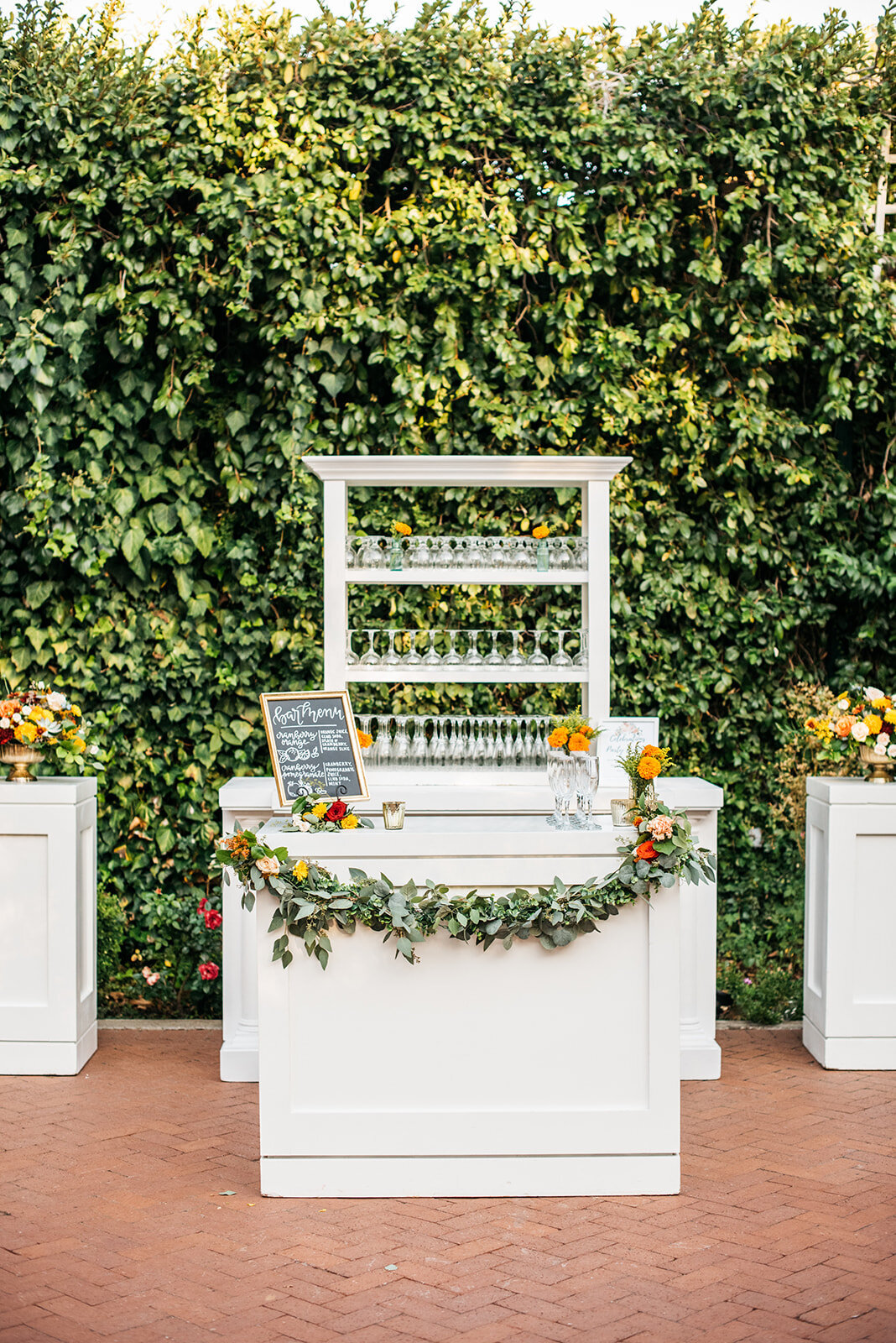 This elegant white bar display is the perfect addition to the cascading ivy wall in the Gardens Courtyard.