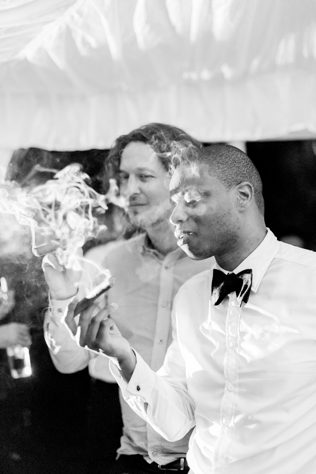 Groom and groomsmen smoking Cuban cigars at Barbados destination wedding