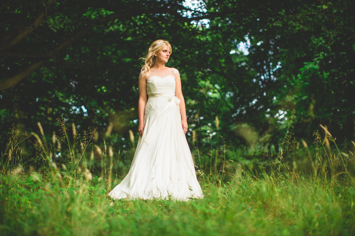 bride in a field of hey