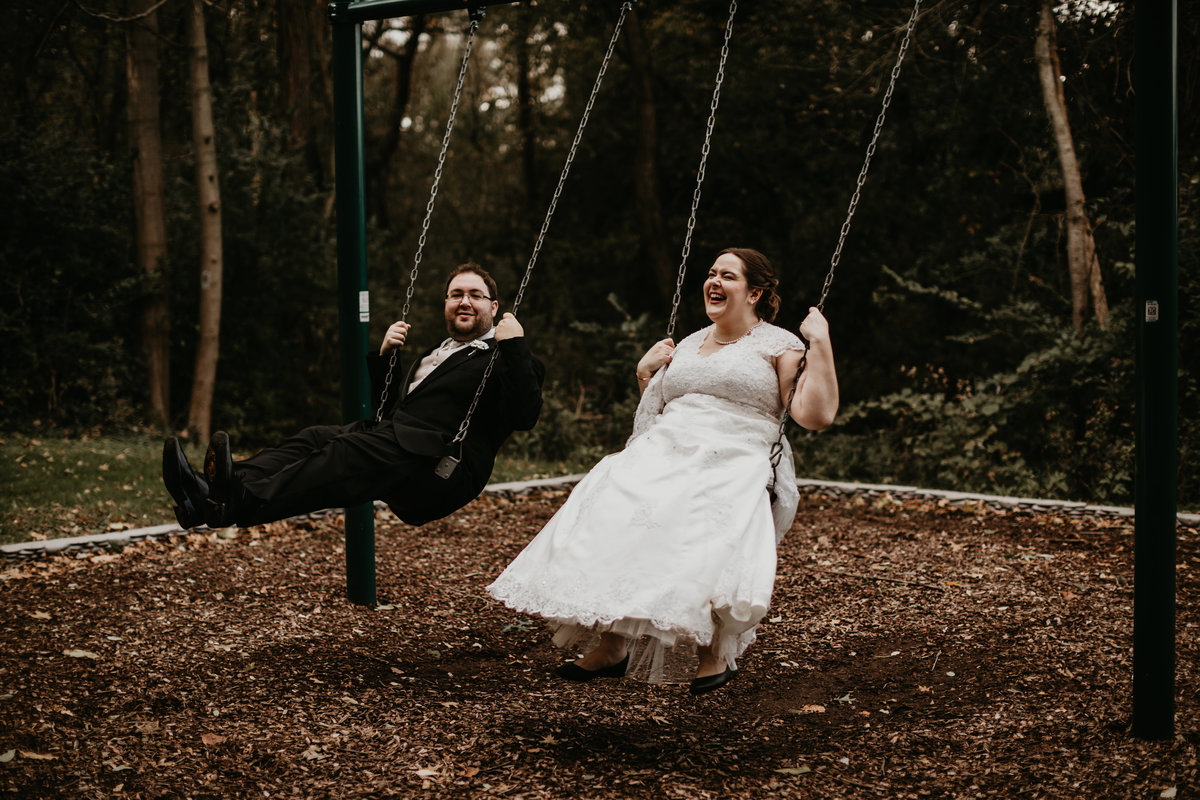 Bride and Groom on swings on their wedding day in Pittsburgh, Pennsylvania