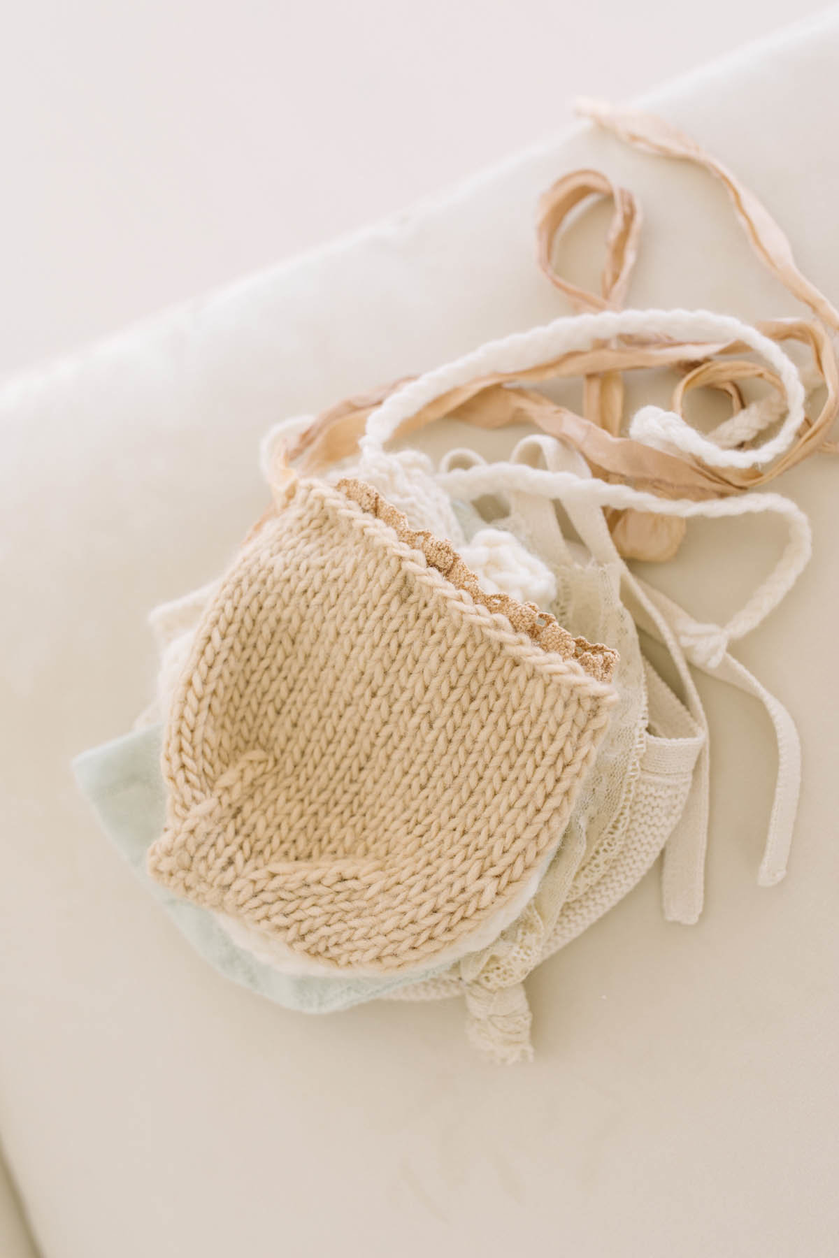 Laurie Baker has a large collection of baby bonnets and hats for her newborn sessions